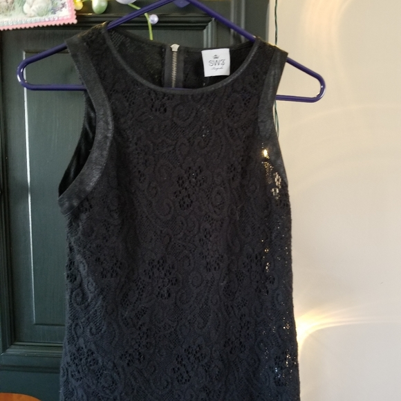 Sexy, lacey, zip back top, leather trim